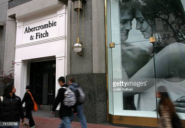 People walk by an Abercrombie and Fitch retail store May 10 2007 in San Francisco California US retailers are reporting slumping samestore sales for...