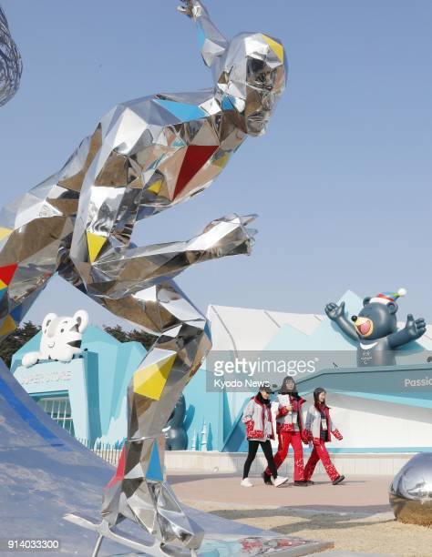 People walk by an artistic statue on display at Olympic Park in Gangneung South Korea on Feb 3 2018 ==Kyodo