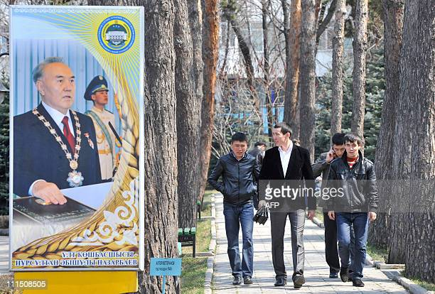 People walk by an election poster of Kazakh President Nursultan Nazarbayev in Almaty on April 2 2011 Kazakh President Nursultan Nazarbayev is set to...
