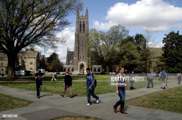 People walk by Duke Chapel on the campus of Duke University in Durham North Carolina US on Friday March 26 2010 Duke offered admission this year to...