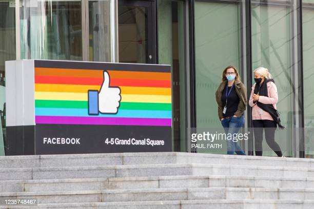 People walk by Facebook's office in the business and financial sector of Dublin City centre on October 7, 2021. - The government of Ireland, one of...
