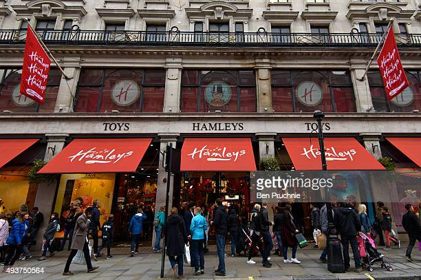 People walk by Hamleys retail toy store on October 22 2015 in London England Chinese footwear retailer CBanner International Holdings is expected to...