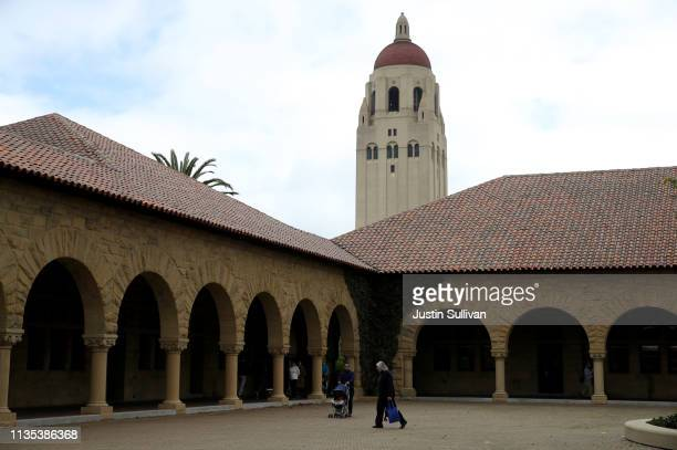 People walk by Hoover Tower on the Stanford University campus on March 12 2019 in Stanford California More than 40 people including actresses Lori...