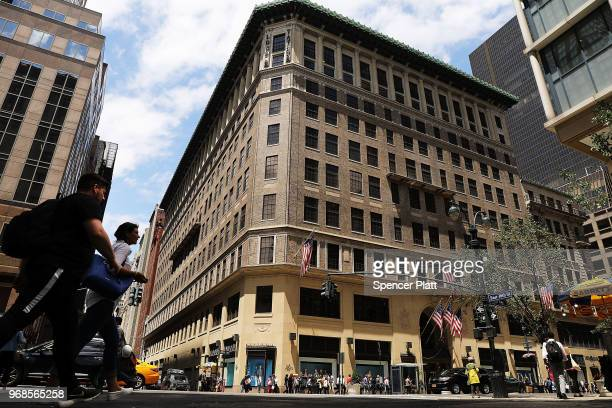 People walk by Lord Taylor's flagship store on 5th Avenue in Manhattan on June 6 2018 in New York City The 192yearold chain owned by Canada's...