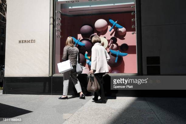 People walk by luxury retail stores in Manhattan on April 06, 2021 in New York City. New York Governor Andrew Cuomo and legislative leaders have...