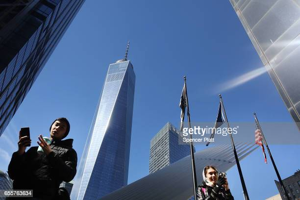 People walk by One World Trade at ground zero in Manhattan on March 20 2017 in New York City Senate Minority Leader Chuck Schumer has been voicing...