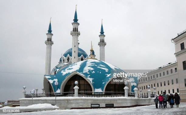 People walk by Qol Sharif mosque in Kazan Republic of Tatarstan Russia February2017
