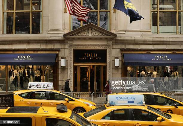 People walk by Ralph Lauren's Fifth Avenue Polo store on April 4 2017 in New York City The luxury brand announced on Tuesday that it will close the...