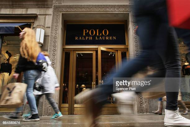 People walk by Ralph Lauren's Fifth Avenue Polo store on April 4, 2017 in New York City. The luxury brand announced on Tuesday that it will close the...