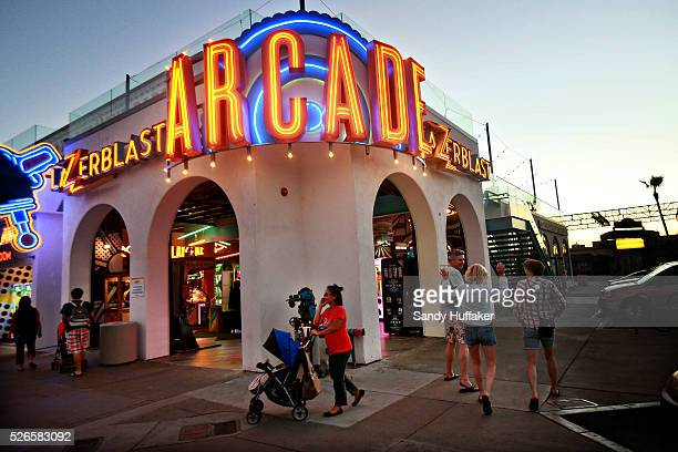 People walk by the Arcade at Belmont Park along Mission Beach in San Diego CA on Monday October 27 2014