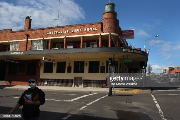People walk by the Australian Arms Hotel on High Street in Penrith on August 09, 2021 in Sydney, Australia. Restrictions for the suburbs of Penrith...