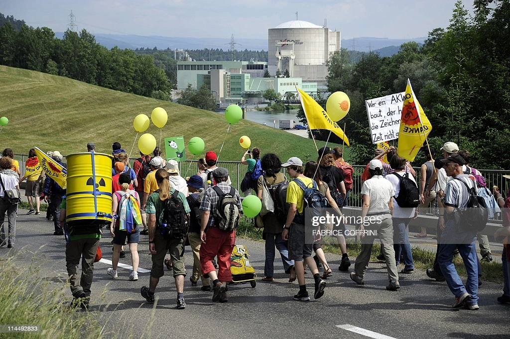 People Walk By The Beznau Nuclear Power Plant The Oldest In