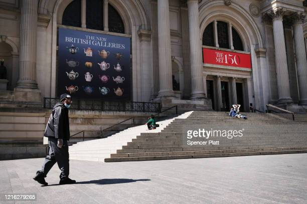 People walk by the closed Metropolitan Museum of Art as fears increasingly grow over the coronavirus on April 01, 2020 in New York City, United...