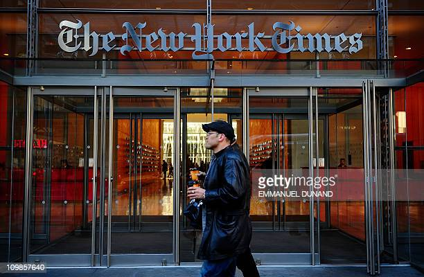 People walk by the entrance to US newspaper 'The New York Times' in New York March 8 2011 AFP PHOTO/Emmanuel Dunand