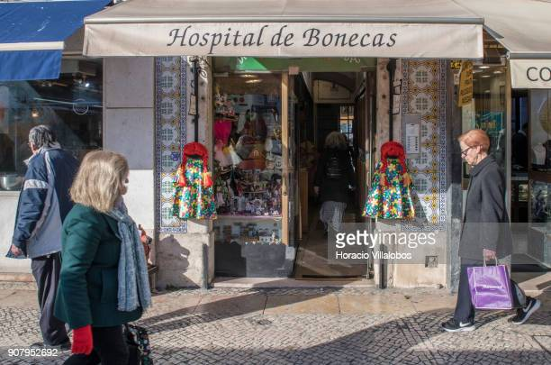 People walk by the 'Hospital de Bonecas' in Praca da Figueira on January 18 2018 in Lisbon Portugal Started in 1830 by Dona Carlota an old lady...