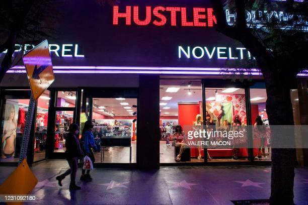 People walk by the Hustler Hollywood store on February 10, 2021 in Hollywood, California. - US porn mogul Larry Flynt, best known as the publisher of...