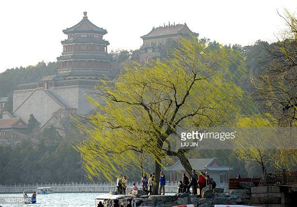 People walk by the Kunming Lake at the Summer Palace in Beijing on April 4 2011 The Summer Palace is an archetypal Chinese garden built during the...