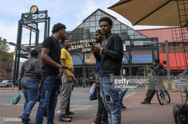 People walk by the landmark Baltimore Lexington Market on April 12 2019 in downtown Baltimore In Baltimore an investigation targeting the Democratic...