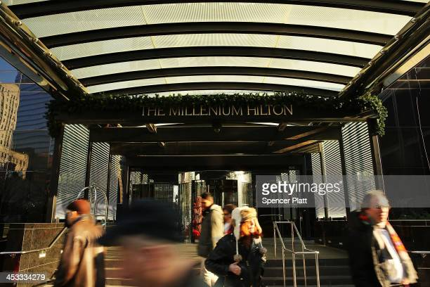 People walk by the Millenium Hilton on December 3 2013 in New York City In a highly anticipated IPO filing scheduled for next week Hilton Worldwide...