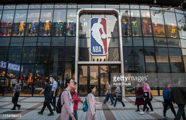 People walk by the NBA flagship retail store on October 9 2019 in Beijing China The NBA is trying to salvage its brand in China amid criticism of its...