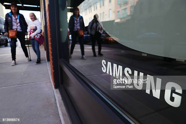 People walk by the new Samsung store in lower Manhattan on October 11 2016 in New York City Less than two months after its launch Samsung Electronics...