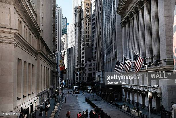 People walk by the New York Stock Exchange near Wall Street on March 21 2016 in New York City Following a strong week for US stocks the Dow Jones...