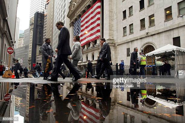 People walk by the New York Stock Exchange November 6 2008 in New York City Worries about the economy still dominate postelection America as the Dow...