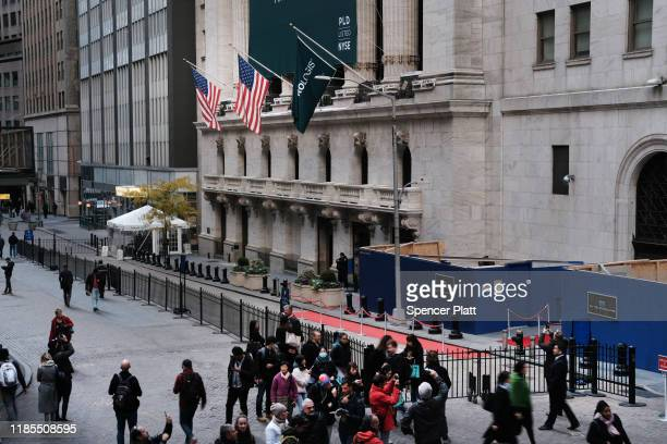 People walk by the New York Stock Exchange on November 04 2019 in New York City US stocks finished at records highs on Monday with the Dow Jones...