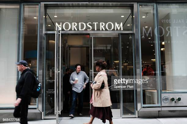 People walk by the newly opened Nordstrom menÕs store the companyÕs firstever Manhattan location in midtown at 57th and Broadway on April 12 2018 in...