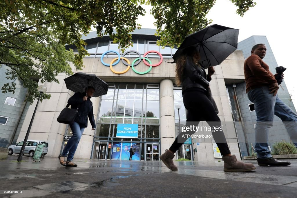 people walk by the olympic swimming pool georges vallerey built for the summer olympic games - Olympic Swimming Pool 2017