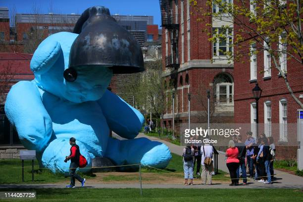 "People walk by the Urs Fischer sculpture ""Untitled "" on the campus of Brown University in Providence, RI on April 25, 2019."