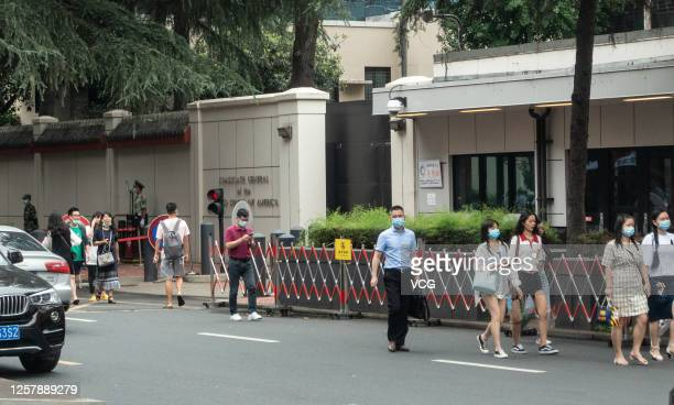 People walk by the US Consulate-General in Chengdu on July 23, 2020 in Chengdu, Sichuan Province of China.