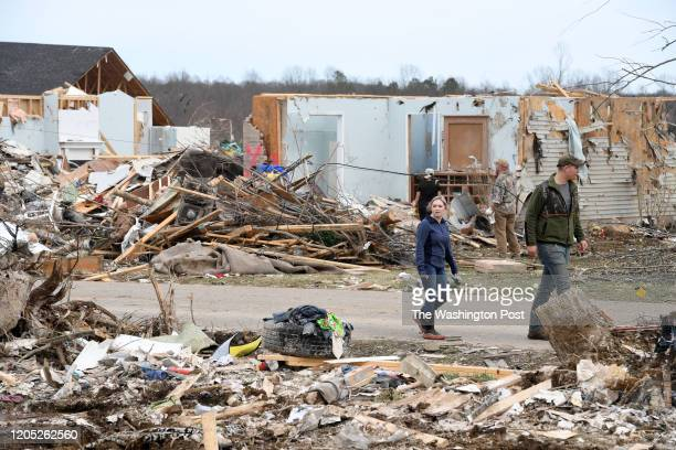 People walk by tornado damage on Wednesday March 04 2020 in Cookeville TN The storms hit the area early Tuesday morning