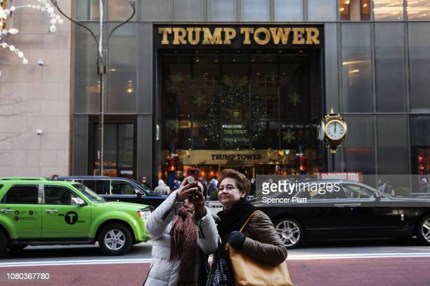 People walk by Trump Tower in midtown Manhattan on December 10 2018 in New York City President Trump's 2016 presidential campaign has come under...