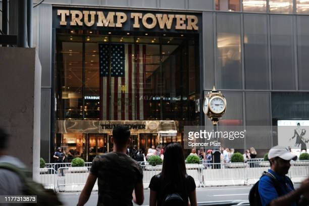 People walk by Trump Tower on September 26, 2019 in New York City. Following the controversy over the phone call between Donald Trump and the...