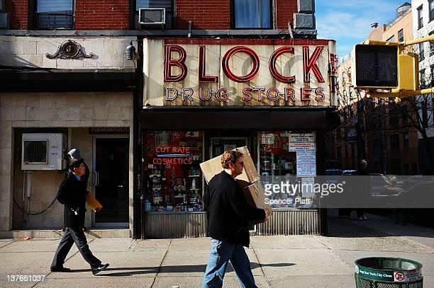 People walk down 2nd avenue in a area of the East Village that the city of New York wants to declare a historic district on January 23 2012 in New...