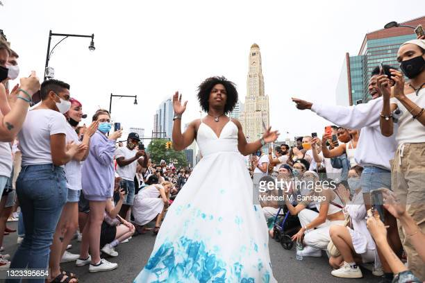 People walk down a makeshift modeling runway as they take a break from marching during the Brooklyn Liberation's Protect Trans Youth event on June...