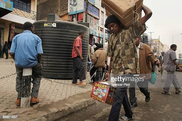 People walk down a market street in Eastleigh, a predominantly Muslim Somali neighborhood on August 18, 2009 in Nairobi, Kenya. Referred to locally...