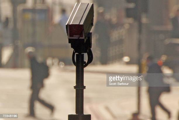 People walk down a street as a camera watches on Novemebr 2, 2006 in London, England. Richard Thomas, the British government's information...