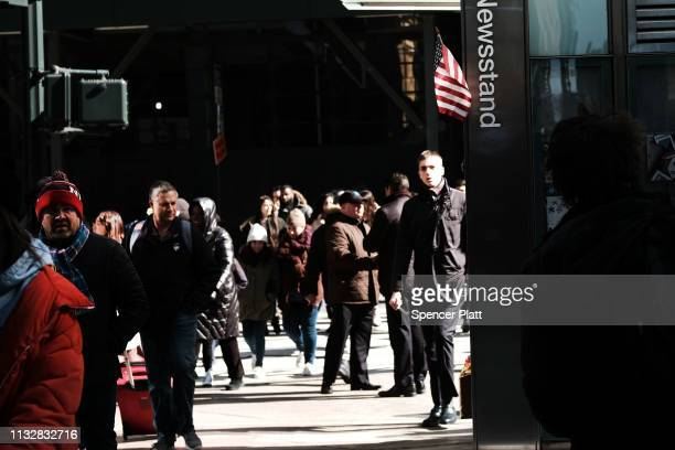 People walk down a street in midtown Manhattan on February 28 2019 in New York City New numbers released today by the Commerce Department show that...