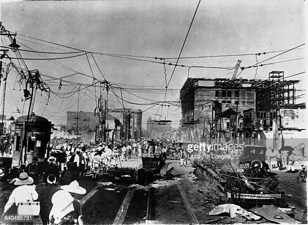People walk down a street in the Ginza district among the ruined buildings after the earthquake in Tokyo, September 1923.