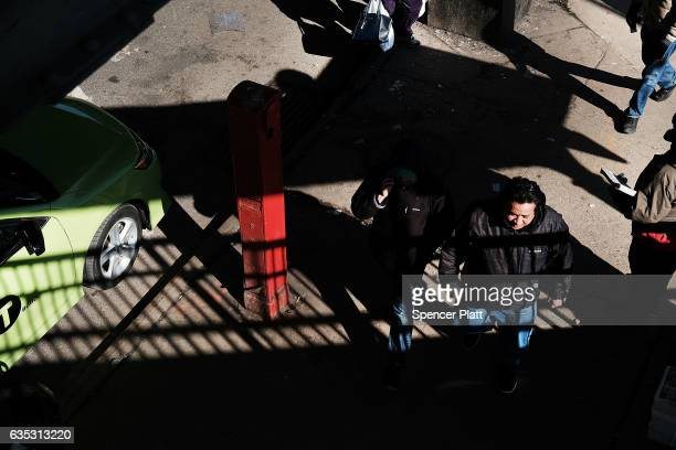 People walk down a street in the Jackson Heights neighborhood with a large Latino immigrant population on February 14 2017 in the Queens borough of...