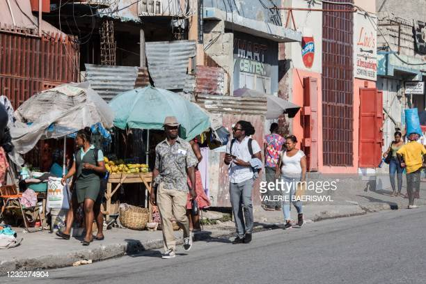 People walk down a street of Port-au-Prince on April 12, 2021.