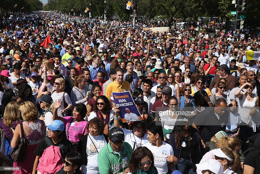 People walk down Constitution Avenue and head out of the security zone after Pope Francis paraded past along the National Mall September 23, 2015 in Washington, DC. Thousands of people gathered near the Ellipse to catch of glimpse of Pope Francis after he addressed an audience of 15,000 invited guests on the South Lawn of the White House during an official arrival ceremony with President Barack Obama. The Pope began his first trip to the United States at the White House followed by a visit to St. Matthew's Cathedral, and will then hold a Mass on the grounds of the Basilica of the National Shrine of the Immaculate Conception.
