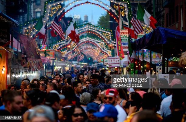 People walk down Mulberry Street during the Feast of the San Gennero in Little Italy in Lower Manhattan on September 14, 2019 in New York City.