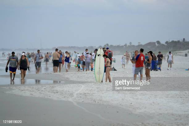 People walk down the beach on April 19 2020 in Jacksonville Beach Florida Jacksonville Mayor Lenny Curry announced Thursday that Duval County's...