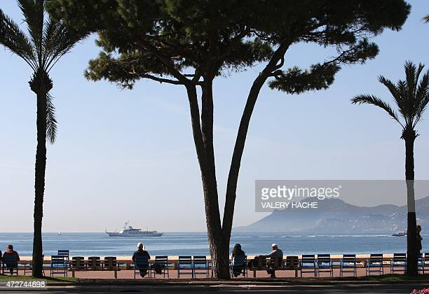People walk down the 'Croisette' on March 17 2009 in Cannes southeastern France two months prior to the begining of the Cannes film festival 62nd...