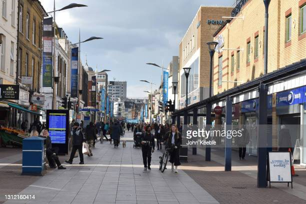 People walk down the High Street on April 12, 2021 in Southend-on-Sea, England. England has taken a significant step in easing its lockdown...