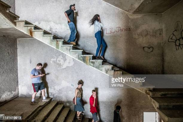 People walk down the stairs of the abandoned Ducor Hotel, once the most prominent hotels in Monrovia, Liberia.