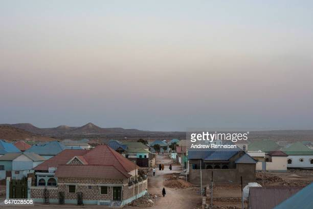 People walk down the street on February 27 2017 in Garowe Somalia Somalia is currently on the brink of famine with over half of the country's...